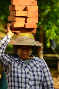 Women working for building houses (this is very normal in Myanmar!)