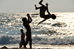 Boys playing at the beach