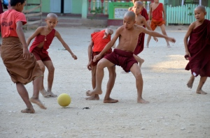 Boys in Aung Myae Oo playing football.