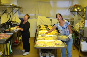 Veronica and Kay preparing Pizza for 70 guests