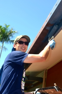 Silvan painting the gutter